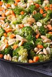 Beautiful salad of broccoli with peanut on a plate macro. vertic Royalty Free Stock Image
