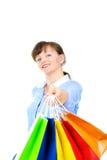 Beautiful sales associate. Beautiful excited sales associate hanging bags stock photo