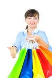 Beautiful sales associate. Hanging shopping bags stock image