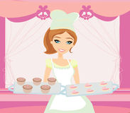 Beautiful saleswoman in a bakery Stock Photo