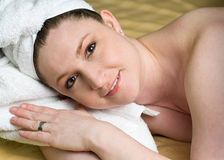Beautiful Salon Woman Relaxing at Spa. With white towel wrapped head Stock Images