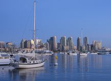 Beautiful San Diego skyline with sailboats and downtown after sunset. SAN DIEGO, CALIFORNIA, USA - OCTOBER 16, 2017: Autumn generally brings warm weather with Royalty Free Stock Image