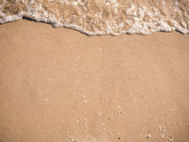 Beautiful sand background and wave from sea. Sand Texture backgr Stock Photo