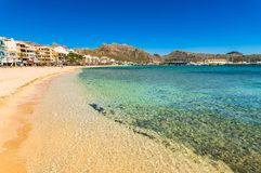 Spain Mallorca beach at seaside of Port de Pollenca. Beautiful sand beach at bay of Pollensa, seaside on Mallorca, Spain Mediterranean Sea Royalty Free Stock Image