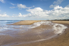 Beautiful sand beach at Malahide, Dublin, Ireland. Beautiful sand beach with a stream at Malahide, Dublin, Ireland royalty free stock photos