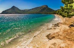 Majorca island, beach landscape at the seaside of Platja de Formentor. Beautiful sand beach scenery on Mallorca island, beach Platja de Formentor, Spain Royalty Free Stock Images