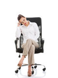 Beautiful sand business woman sitting on a chair. Royalty Free Stock Image