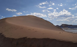 Beautiful sand dune with leading lines of sand into the atacama desert. Beautiful sand line in the dunes of the atacama desert stock photo