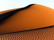 Beautiful sand dunes at sunset. Sunlight highlighting the dunes in the Sahara Stock Image