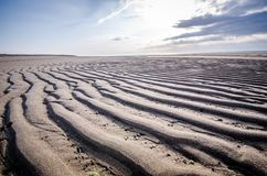 Beautiful sand ripples and waves along the pristine Race Point beach at Cape Cod National Seashore at dusk.  stock images