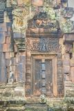 Beautiful sandstone craved on the lintel, doorway and windows of. Lord Krishna killing Lion in Bapuan Khmer art at Phra That Narai Cheng Weng, Sakon Nakhon Stock Images