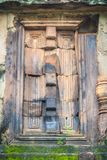 Beautiful sandstone craved on the lintel, doorway and windows of. Lord Krishna killing Lion in Bapuan Khmer art at Phra That Narai Cheng Weng, Sakon Nakhon Stock Photo