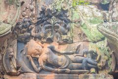 Beautiful sandstone craved on the lintel, doorway and windows of. Lord Krishna killing Lion in Bapuan Khmer art at Phra That Narai Cheng Weng, Sakon Nakhon Stock Photography