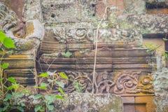 Beautiful sandstone craved on the lintel, doorway and windows of. Lord Krishna killing Lion in Bapuan Khmer art at Phra That Narai Cheng Weng, Sakon Nakhon Stock Photos