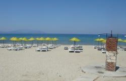 Beautiful sandy beach on the aegean sea. Beautiful sandy beach on the beautiful and wonderful shore of the Aegean Sea near the resort of Kusadas, waiting for stock image