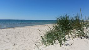 Beautiful sandy beach with clear blue water and blue sky, Island of Bornholm in Denmark Royalty Free Stock Photo