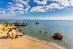 Beautiful sandy beach. The coast of Portugal. Royalty Free Stock Image