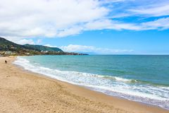 Beautiful sandy beach on the coast of Tyrrhenian sea in Italian Cefalu taken during off season. The small city in Sicily. Is a popular vacation destination royalty free stock image