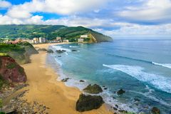 Beautiful sandy beach with good waves for surfing in Bakio, Basque country, Spain. In sunny day stock images