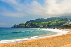 Beautiful sandy beach with good waves for surfing in close to Bilbao city, Basque country, Spain royalty free stock photos