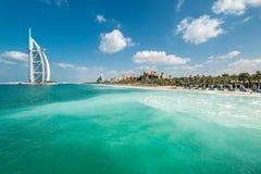 Beautiful sandy beach of Madinat Jumeirah and the Burj Al Arab hotel.  royalty free stock images