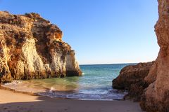Beach near Lagos with the clear waters of the mediterranean in Algarve stock image