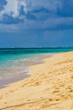 Beautiful sandy beach, sea and sky with clouds Stock Image