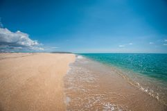 Beautiful sandy beach in a sunny day, landscape royalty free stock image