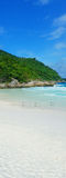 Beautiful sandy beach on a tropical island Stock Images
