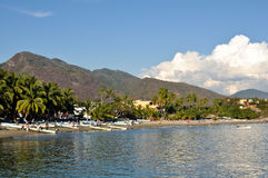 Beautiful Sandy Beach in Zihuatanejo Mexico. With clouds in background Royalty Free Stock Photography