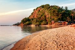 Beautiful sandy tropical beach at sunset, Thailand, Phangan Island stock photo
