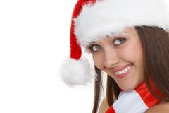 The beautiful santa. The beautiful girl in a christmas red cap Royalty Free Stock Photo