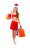 Beautiful Santa christmas girl with shopping bags on white Royalty Free Stock Photo