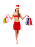 Beautiful Santa christmas girl with shopping bags on white Royalty Free Stock Images