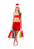 Beautiful Santa christmas girl with shopping bags on white Stock Photo