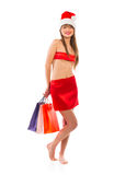 Beautiful Santa christmas girl with shopping bags on white Stock Images