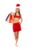 Beautiful Santa christmas girl with shopping bags on white Royalty Free Stock Image