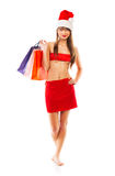 Beautiful Santa christmas girl with shopping bags on white Royalty Free Stock Photos