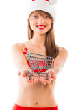 Beautiful Santa christmas girl with shopping trolley Royalty Free Stock Photo