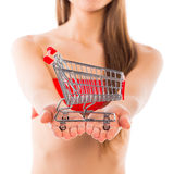 Beautiful Santa christmas girl with small shopping trolley on wh Royalty Free Stock Photos