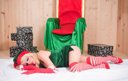 Beautiful Santa Claus assistant sleeping tired Stock Photos