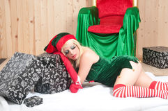 Beautiful Santa Claus assistant sleeping tired Royalty Free Stock Images