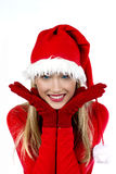 Beautiful Santa Claus girl. Portrait of beautiful girl wearing Santa Claus hat on white background Royalty Free Stock Image