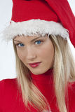 Beautiful Santa Claus girl. Portrait of beautiful girl wearing santa claus hat on white background Stock Image