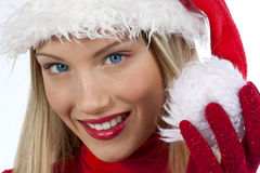 Beautiful Santa Claus girl. Portrait of beautiful girl wearing santa claus hat on white background Stock Images