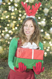 Beautiful Santa Claus girl with Christmas presents Royalty Free Stock Photography