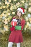 Beautiful Santa Claus girl with Christmas presents Royalty Free Stock Photo