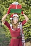 Beautiful Santa Claus girl with Christmas presents Royalty Free Stock Photos