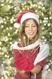 Beautiful Santa Claus girl with Christmas sparklers Stock Photo