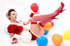 Beautiful santa claus woman with colored balloons Royalty Free Stock Photography